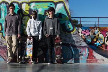 Friends standing in skatepark