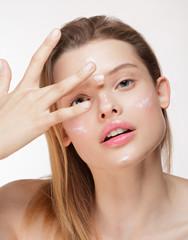 Radian woman applying moisturiser