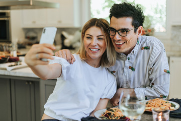 Couple taking a selfie during their dinner