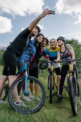 Group of cyclists taking a selfie in the nature