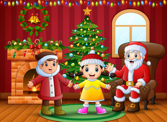Happy two kids celebration a christmas with santa claus