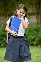 Filipina Child Girl Student And Depression Wearing School Uniform With Notebooks