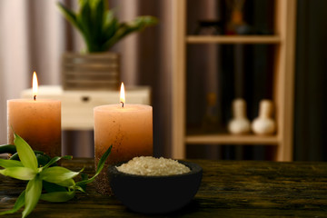 Beautiful spa composition with burning candles on wooden table