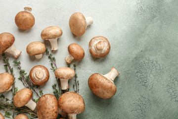 Fresh mushrooms with thyme on color table