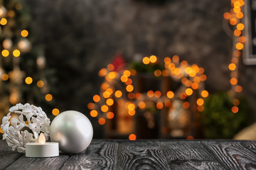 Decorations on wooden table against blurred Christmas interior