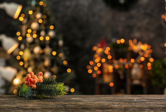 Closeup view of wooden table against blurred Christmas interior