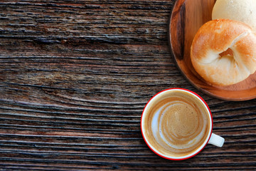 Start the Day by Fresh Homemade Bagel Bread and Hot Coffee Latte Cup on Wooden Table in the Morning, Top View