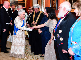 Britain's Queen Elizabeth greets guests at an evening reception for members of the Diplomatic Corps at Buckingham Palace in London