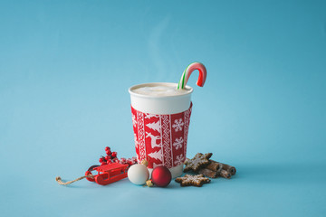 Cup of coffee with christmas decoration. Hot winter drink background. Minimal food concept.