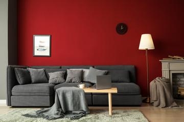 Wall Mural - Stylish interior of room with comfortable big sofa