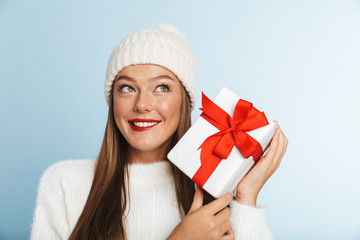 Cheerful young woman wearing sweater