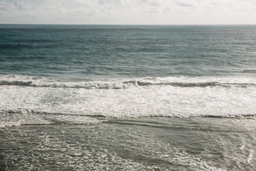 Beautiful view of the water surface with the waves of the Atlantic Ocean. Ahead is the horizon.
