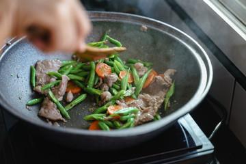 Cooking stir fried string bean vegetables