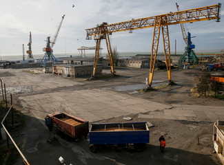 A truck with grain and cranes are seen in the Azov Sea port of Berdyansk