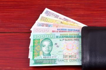 Guinean money in the black wallet
