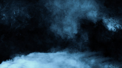 Blue toned . Rolling billows of smoke mist clouds from dry ice across the bottom light . Fog on  floor isolated background  black texture .