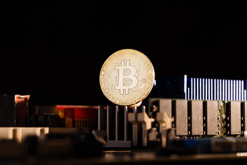 Picture of crypto currency, bitcoin and processor on orange background