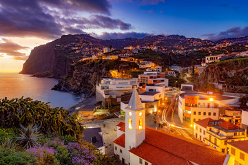 Night scene of Camare de Lobos, illuminated architecture of the town, Madeira island, Portugal Wall mural