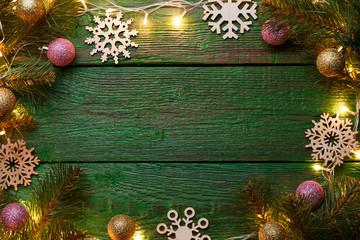 Image of New Year's wooden green background with burning garland
