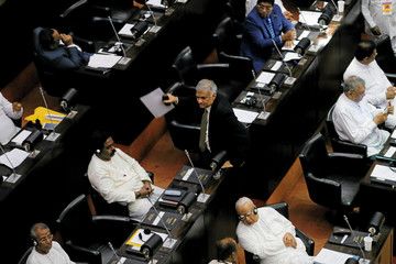 Sri Lanka's ousted PM Wickremesinghe leaves a parliament session in Colombo