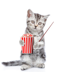 Funny kitten with popcorn pointing away. isolated on white background