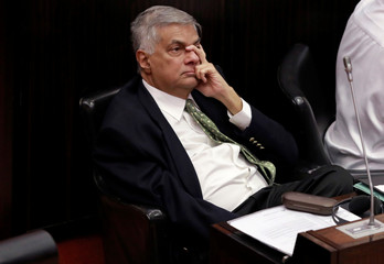 Sri Lanka's ousted PM Wickremesinghe looks on during a parliament session in Colombo