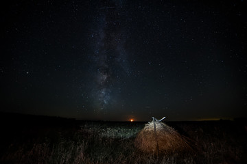 Haystack in the meadow and the Milky Way.