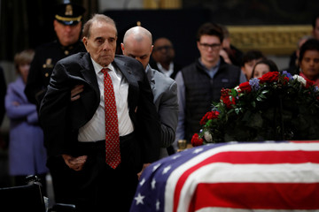 Former Senator Bob Dole pays his respects at the casket of former U.S. President George H.W. Bush as it lies in state inside the U.S. Capitol Rotunda on Capitol Hill in Washington