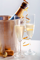 Pair glass of champagne with bottle in metal container. New Year celebration