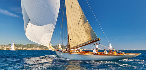 Luxury sailing yachts under sails. Yachting sport competition
