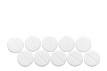 White pills isolated on white background. Close-up view. Medical background. Healthcare image.