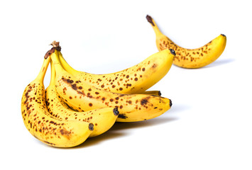 Spotted bananas isolated on white