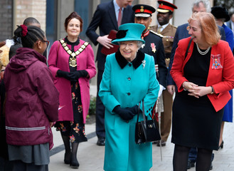 Britain's Queen Elizabeth, walks with Coram CEO Carol Homden during a visit to children's charity Coram in London
