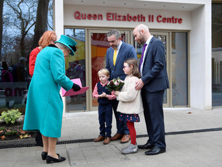 Britain's Queen Elizabeth, receives a Christmas card during a visit to children's charity Coram in London
