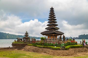 Pura Ulun Danu Beratan in cloudy day, famous temple on the lake, Bedugul, Bali, Indonesia.