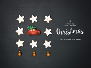 christmas background with lettering merry christmas and different small christmas items on blackboard