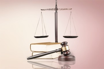 Justice Scales, gavel and books on light background