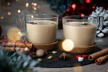 masala tea. kettle and two mugs. Christmas
