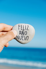 stone with the text happy new year in spanish