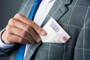 businessman with czech korunas banknotes