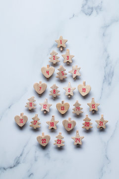 Festive Christmas advent calendar made from wooden shapes