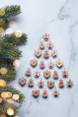 Festive Christmas advent calendar made from wooden shapes with tree branches