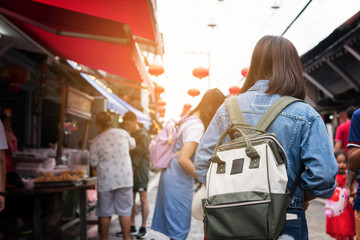 Asian women traveler in china market. she is shopping and travel.