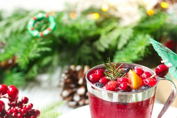 Christmas Cranberry cocktail drink on festive X-mas background