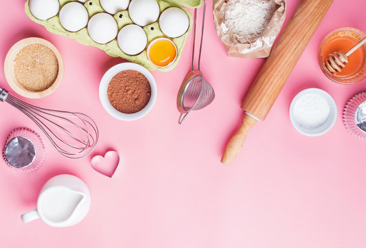 Tools and ingredients for making sweet bakery like pie or cupcakes.