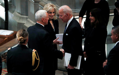Vice President Pence talks with former Vice President Biden at state funeral for former U.S. President George H.W. Bush at Washington National Cathedral