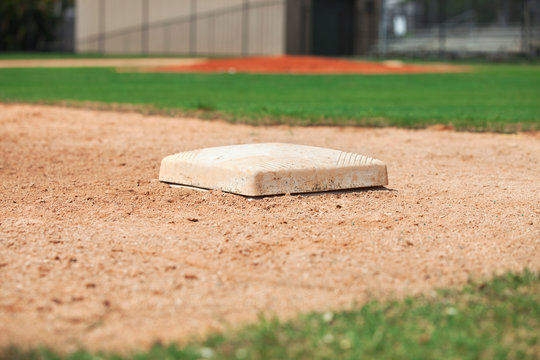 Close up low angle view of third base on a youth baseball field