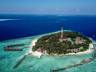 Island resort in Indian ocean, Maldives aerial view