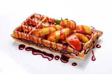 Belgian sweet waffles on a white background. Stuffed with peaches and syrup