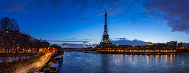 Fotobehang Eiffeltoren Eiffel Tower and Seine River banks in early morning light. Panoramic view in Paris, France